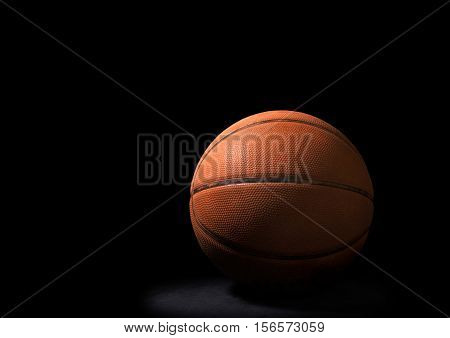 Still Life of a Basketball on Black Background