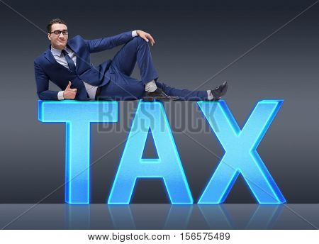 Businessman in tax burden business concept