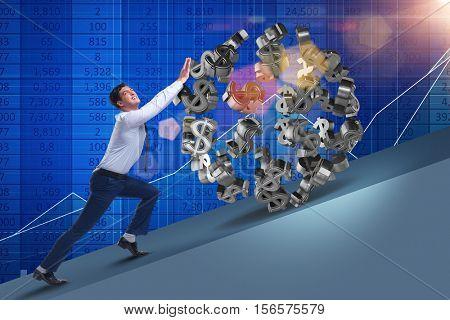 Businessman pushing away dollar ball