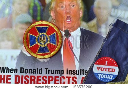 ILLUSTRATIVE EDITORIAL.Chevron of Ukrainian nazionalist battalion.USA Elections poster - background.November 10,2016,Kiev, Ukraine