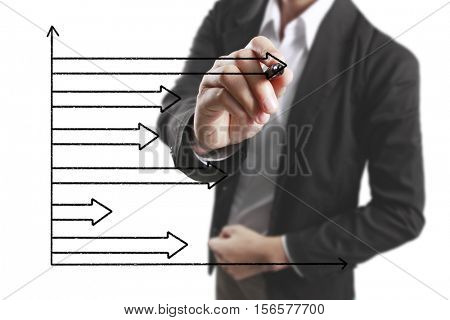 Businessman drawing graphics  growing graph