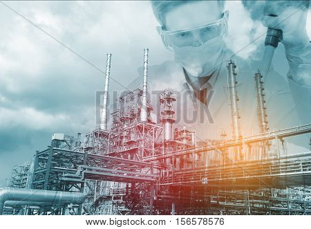 scientist with equipment and science experiments Laboratory glassware with petrochemical plant background.