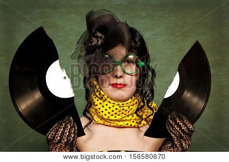 Happy woman with a vinyl disk in her hands. Photo in old image style