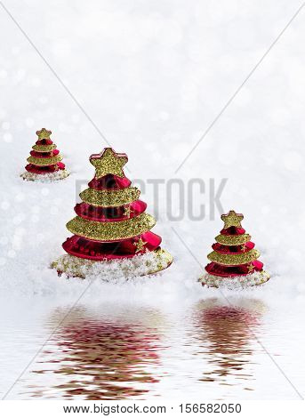 Glass toy Christmas tree in snow. New Year card.
