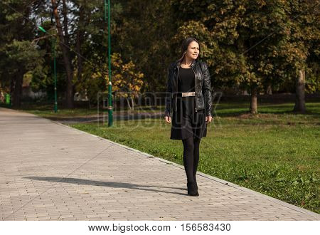 Lonely teenage girl in the autumn park