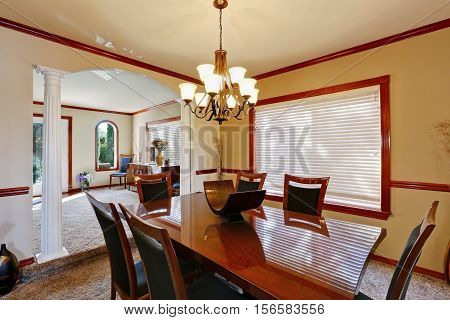 Well Furnished Dining Room With Elegant Chandelier