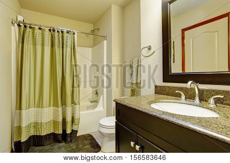 Clean Bathroom Interior In Green And Brown Tones.