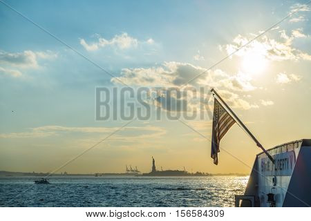 American flag with  Statue of Liberty, New York City , USA  ( Filtered image processed vintage effect. )