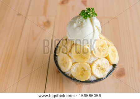 Korean style bing su fresh banana shaved ice on wood table