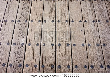 brown wood texture and background with black pin
