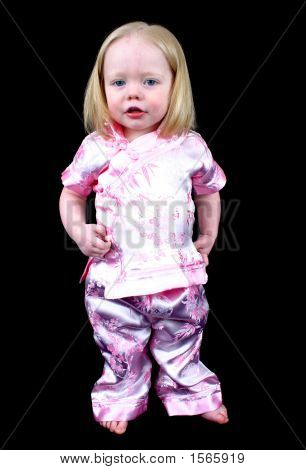 Cute Little Girl On A Black Background