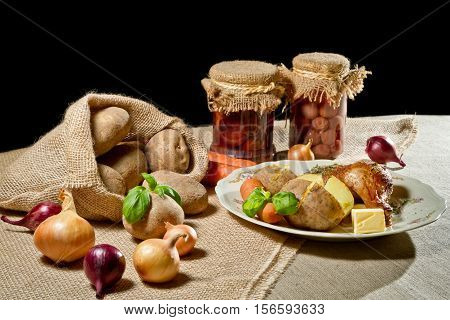 Rural Meal With Jacket Potatoes, Roasted Meal And Vegetables