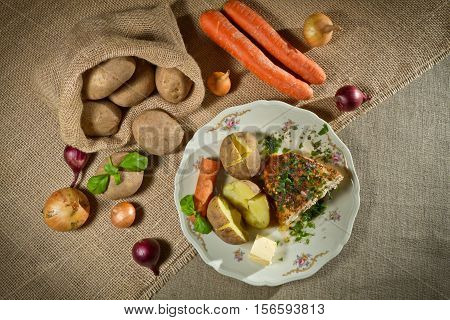 Vegetables, Jacket Potatoes, And Roast Chicken In Rural Meal