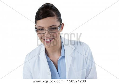 Beautiful female doctor smiling against white background