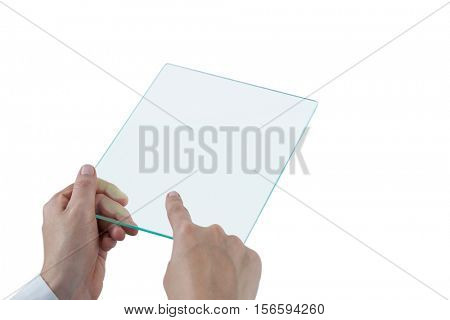 Hands of female doctor using digital tablet against white background