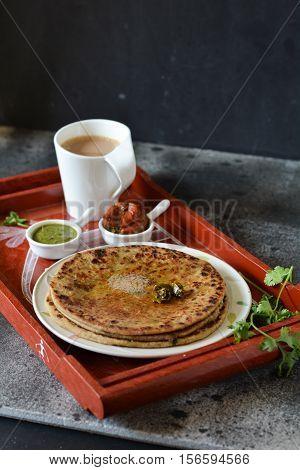Indian flatbread stuffed with mashed potatoes /Aloo Paratha