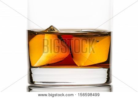 Closeup Whisky With Ice Cubes On White Background