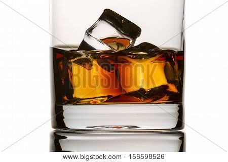 Closeup Brandy With Glass And Ice Cubes On White Background