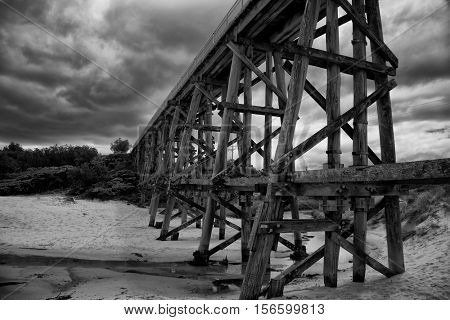 Trestle bridge in Kilcunda, Australia, 91 meter long built over the Bourne Creek.  Black and white.
