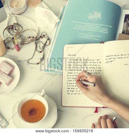 Woman Writing Journal Concept