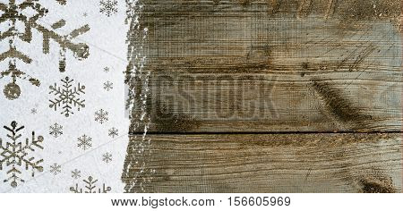 christmas card or new year background made of snowflakes symbols handwritten on snow and wooden table