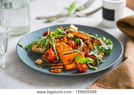 Grilled Butternut squash with cherry tomato and rocket salad