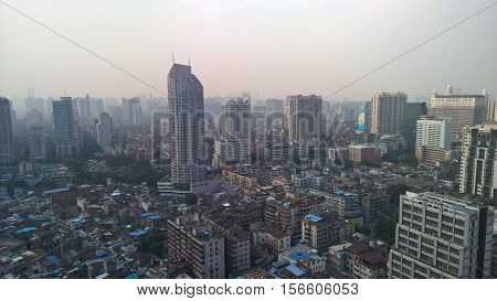 Guangzhou cityscape in Guangdong, China, in the mist.