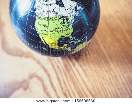 World Globe Map close up United state of America Wooden background Education resouce
