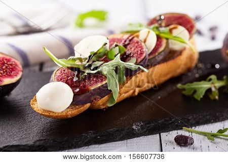 Fig and Goat Cheese Bruschetta with Rocket Salad