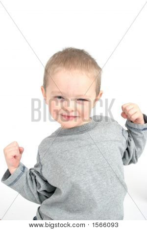 Cute Little Boy Showing Off His Muscles