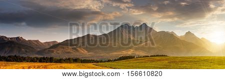 Rural Field In Tatra Mountains At Sunrise