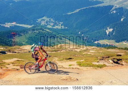Bucegi Mountains, Romania July 09, 2015: Unidentified Biker Climbs The Hill In Bucegi Mountains In R