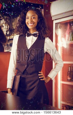 Portrait of bartender standing with menu card against flying colours