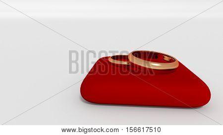 Golden wedding rings on red pillow 3d render
