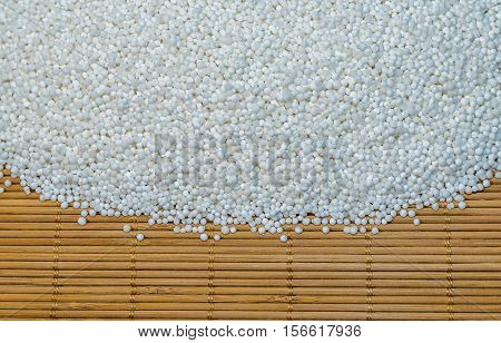 Background - raw tapioca seedson the wooden mat