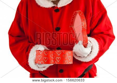 Mid section of santa claus opening a gift box