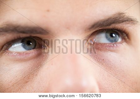 Close-up of man wearing contact lens