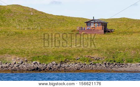 Single house on an small island at the westcoast of Iceland