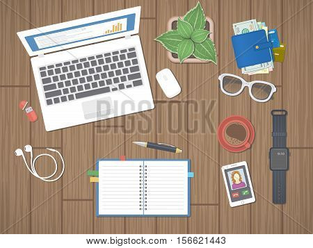 Workplace in office. Work in a team, Work activity. Office work equipment on a wooden table. Laptop, notepad, pen, smart watches, phone, wallet, flash drive, headphones, coffee. Top view. Vector