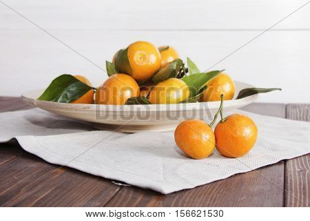 Still life with tangerines (mandarins) on a plate