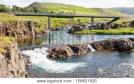 Bridge over a small river and the car on it Iceland