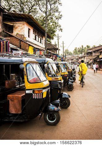 yellow rickshaws tuk tuk in streets of Gokarna Karnataka India