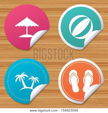 Round stickers or website banners. Beach holidays icons. Ball, umbrella and flip-flops sandals signs. Palm trees symbol. Circle badges with bended corner. Vector