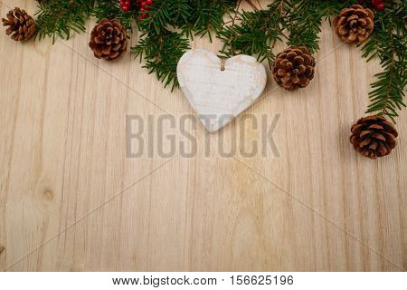 Christmas fir tree decorated on wooden background