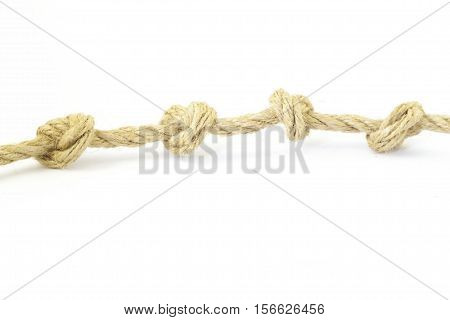 Rope with knots on the white background.