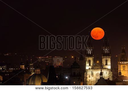 Full moon between towers of Church of Our Lady before Tyn Prague Czech Republic.