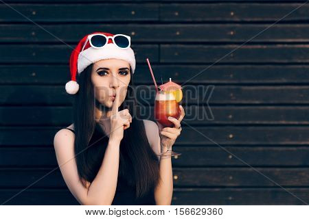 Girl with Cocktail Drink Keeping a Secret at Christmas Party