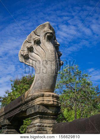 Seven heads Naga sand stone carving statue at Phimai historical park. Prasat Hin Phimai Nakhon ratchasima Thailand.