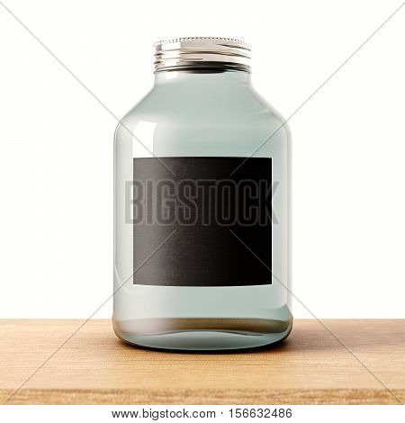 One empty jar of transparent glass with closed metal cap on the wood desk.White wall at background.Clean glassy container and black mockup label.Drinks, food storage concept.3d rendering