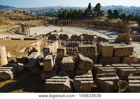 Photo of the Overlook from Great Temple of Zeus on Oval Plaza ancient city Jerash, Jordan. Tourist attraction, vacation and sightseeing concept. poster